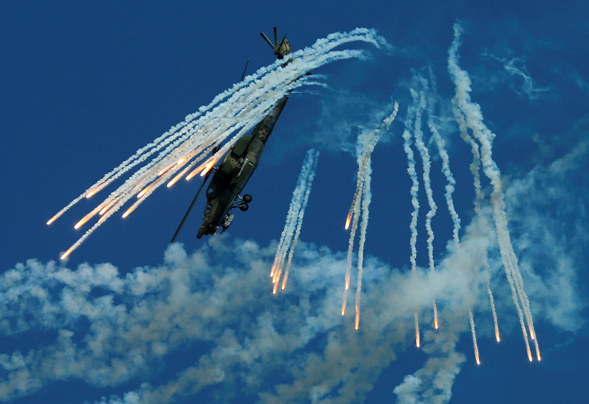 A Mil Mi-28N Night Hunter military helicopter performs in Dubrovichi outside Ryazan. [Maxim Shemetov/Reuters]