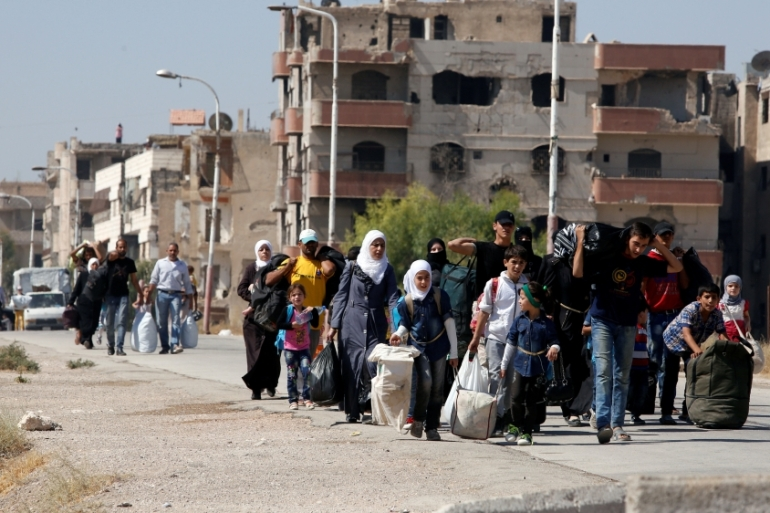 More than 300 people were evacuated from the besieged Damascus suburb of Moadamiyeh on Friday [Reuters]