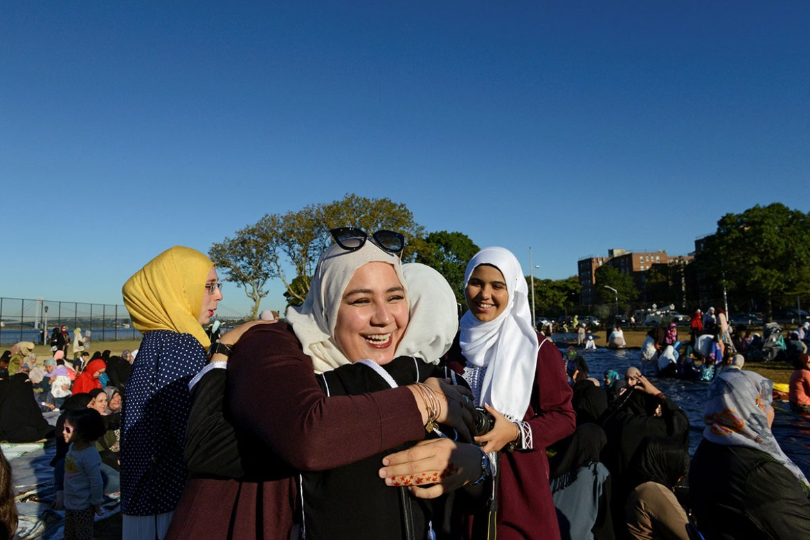 People greet each other before a group prayer session for the Muslim holiday Eid al-Adha in the Brooklyn borough of New York City, US [Stephanie Keith/Reuters]