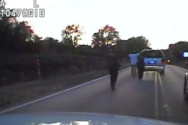 In the footage, Crutcher is seen walking to his car with his hands up before he is shot [AP]
