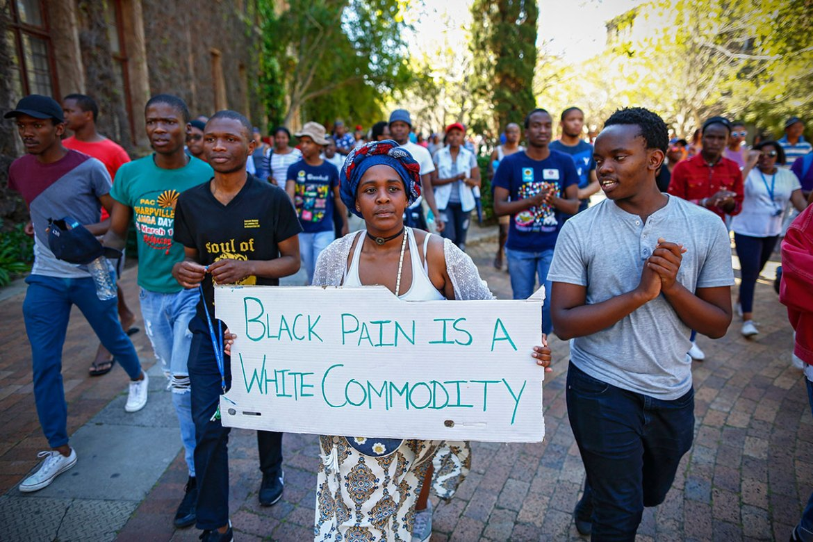 Students chant slogans during a demonstration at the University of Cape Town. The university has called off classes, lectures and tests as students protested about increases in tuition fees. [Nic Bothma/EPA]