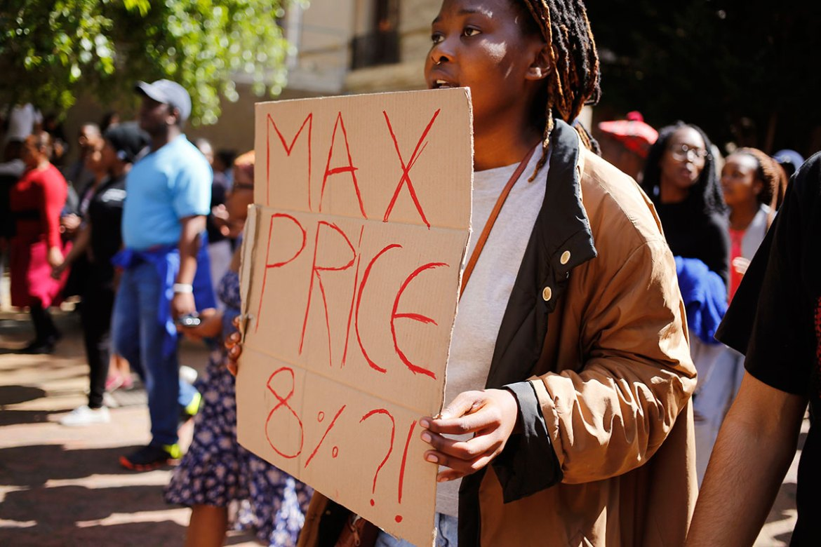Demonstrators say price increases discriminate against black students with low family incomes. [Schalk van Zuydam/AP]