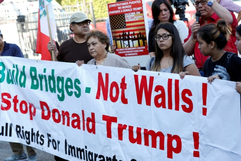Protesters rallied against Trump's immigration policies before his visit to Mexico prior to his election [Reuters]