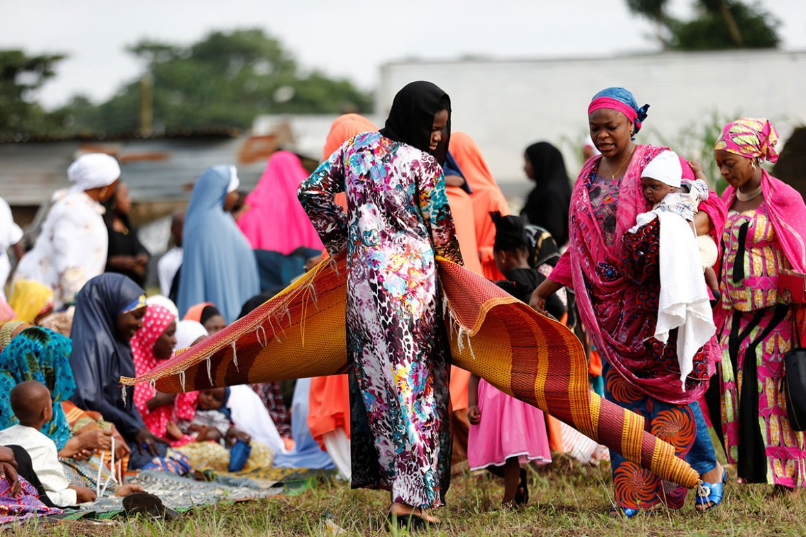 Women arrive to attend prayers at an open prayer ground in Lagos, Nigeria. [Akintunde Akinleye /Reuters]