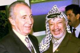 Yasser Arafat and Shimon Peres share a laugh during a meeting in September 1999 [Pino Farinacci/EPA]