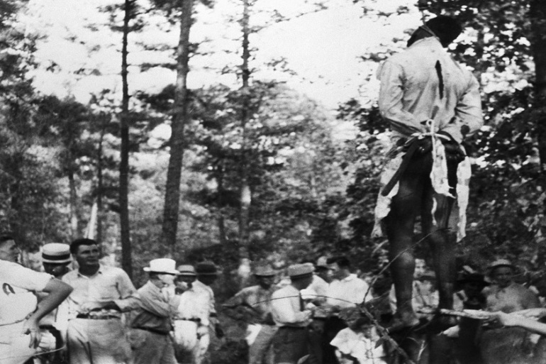A photo from 1938 shows the lynching of a black man in Ruston, Louisiana state [Getty Images]