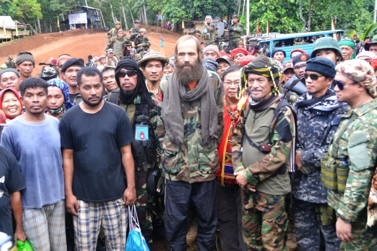 Sekkingstad, centre, and three Indonesians to his right are photographed in Indanan town [Nickee Butlangan/AFP]
