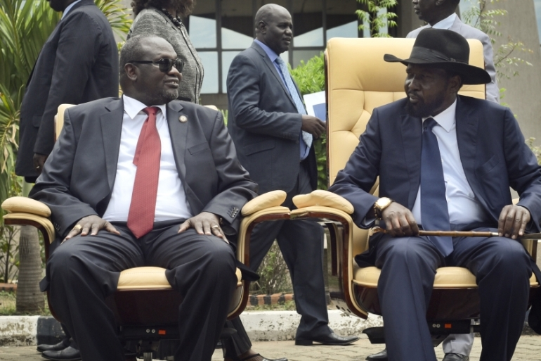 President Kiir, right, and Machar are under increasing international pressure to resolve their differences [File: Jason Patinkin/AP]