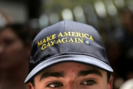 A man wears a hat that says 'Make America Gay Again', a parody of Donald Trump''s campaign slogan [Reuters]