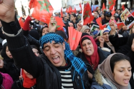 Moroccan protesters wave national flags during a rally against the UN Secretary-General Ban Ki-moon in Rabat, Morocco in March 2016 [EPA]