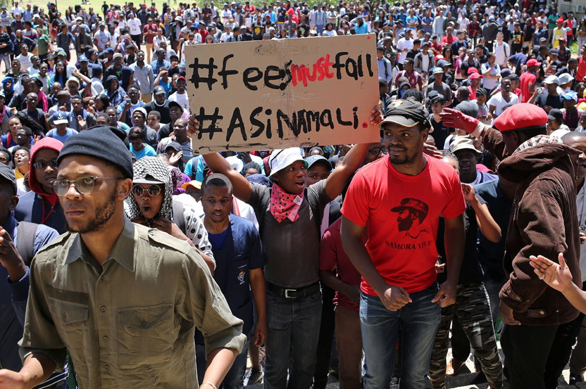 A demonstrator holds a placard during student protests demanding free education at the Johannesburg's University of the Witwatersrand. [Siphiwe Sibeko/Reuters]