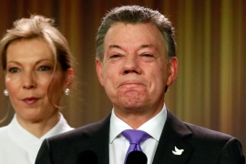 Santos addresses the media next to his wife after winning the Nobel Peace Prize at Narino Palace in Bogota, Colombia [Reuters]