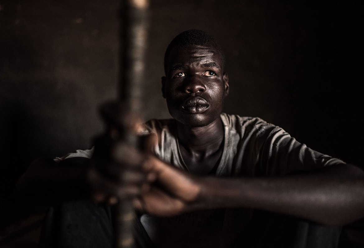 Okello Norwell, 21, used to be a star student at school, but his education ended after he lost his sight to Onchocerciasis as a boy. Three other members of his family are also now blind. [Tommy Trenchard/Al Jazeera]