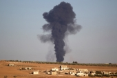 Smoke rises from al-Bab city, northern Aleppo province, Syria [Reuters]