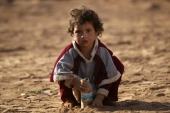 An Iraqi refugee girl in al-Kherbeh village, northern Aleppo province, Syria [Reuters]