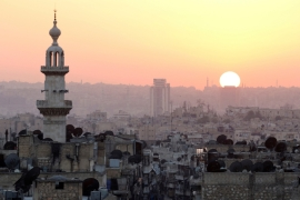 The sun sets over Aleppo, as seen from rebel-held part of the Syrian city [Reuters]