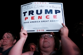 A Trump supporter holds up a sign at a campaign rally in Florida [Mike Segar/Reuters]