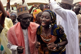 Family members celebrate after being reunited with the kidnapped Chibok girls [AP]