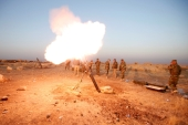 Peshmerga forces fires a mortar towards ISIL militant positions in the town of Naweran near Mosul [Reuters]