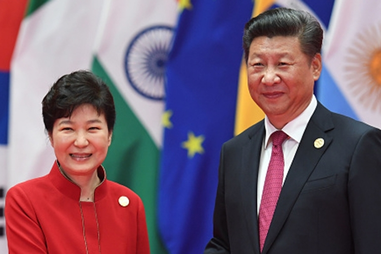 South Korea's President Park Geun-Hye is greeted by China's President Xi Jinping in Hangzhou [Getty]