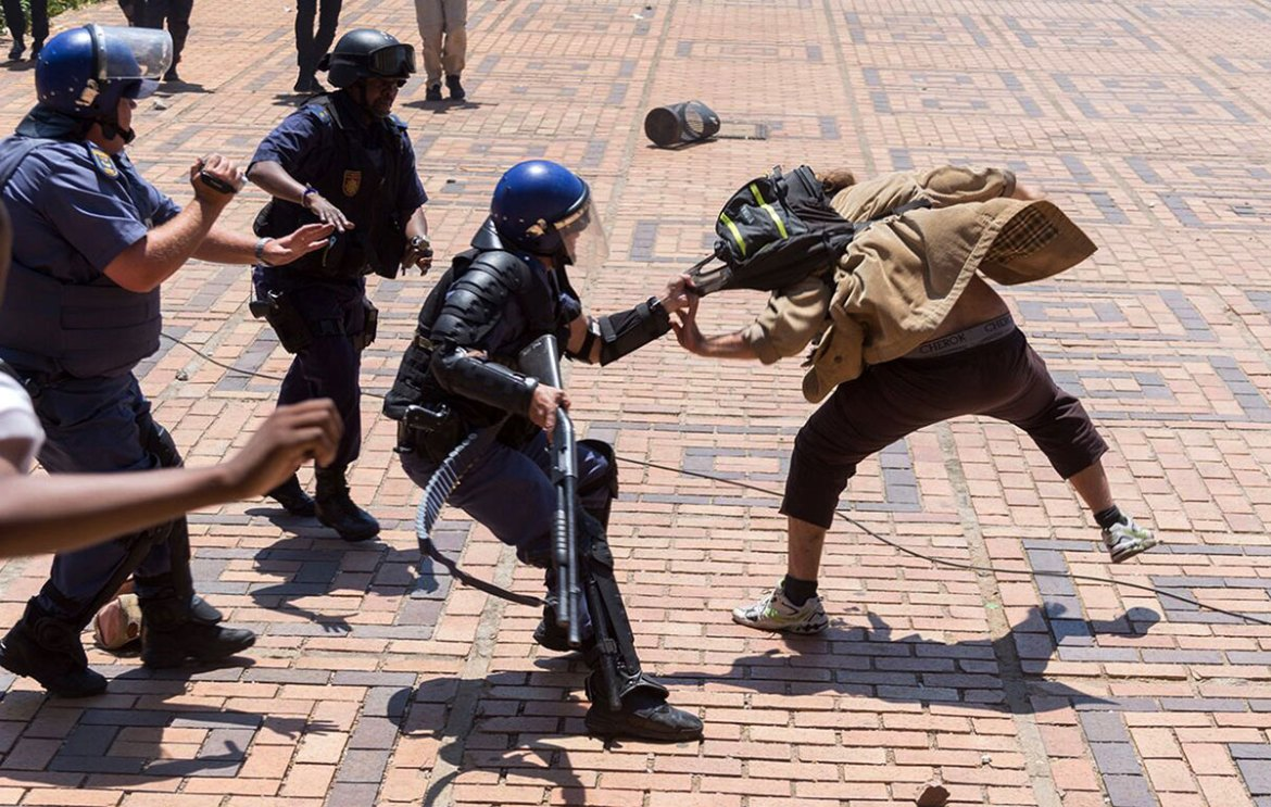 There were scuffles between students and police at the University of the Free State in Bloemfontein, 400 km (240 miles) south of Johannesburg. [Yeshiel Panchia/AP]