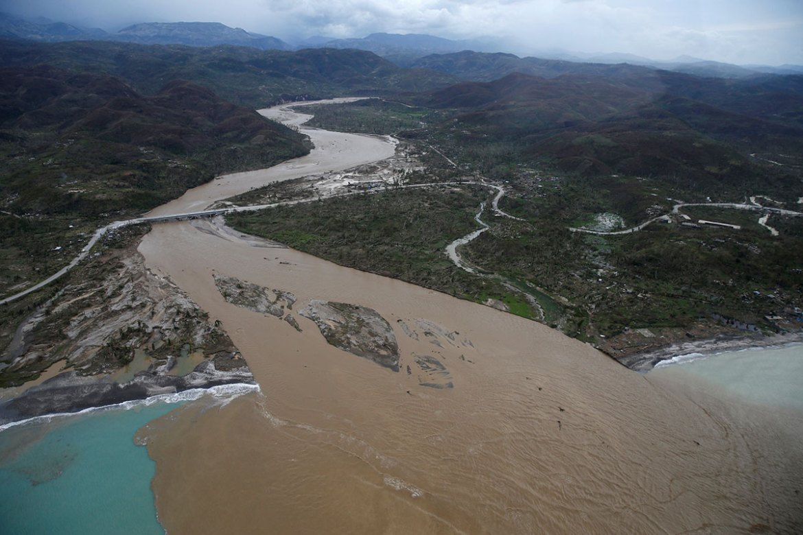A flooded river is seen in Jeremie. [Carlos Garcia Rawlins /Reuters]