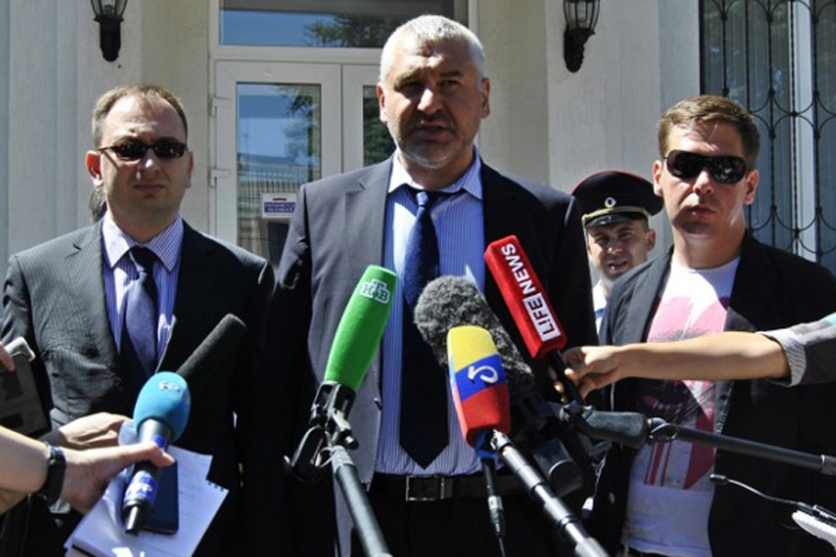 Russian lawyer Mark Feygin, middle, will reportedly defend Sushchenko in court [AFP]