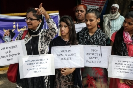 Women activists hold placards during a protest against the statements made by the All India Muslim Personal Law Board against the triple talaq ban [EPA]