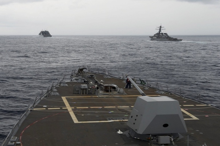 This picture taken on October 17 shows the guided-missile destroyer USS Decatur, right, in the South China Sea [US Navy via AP]