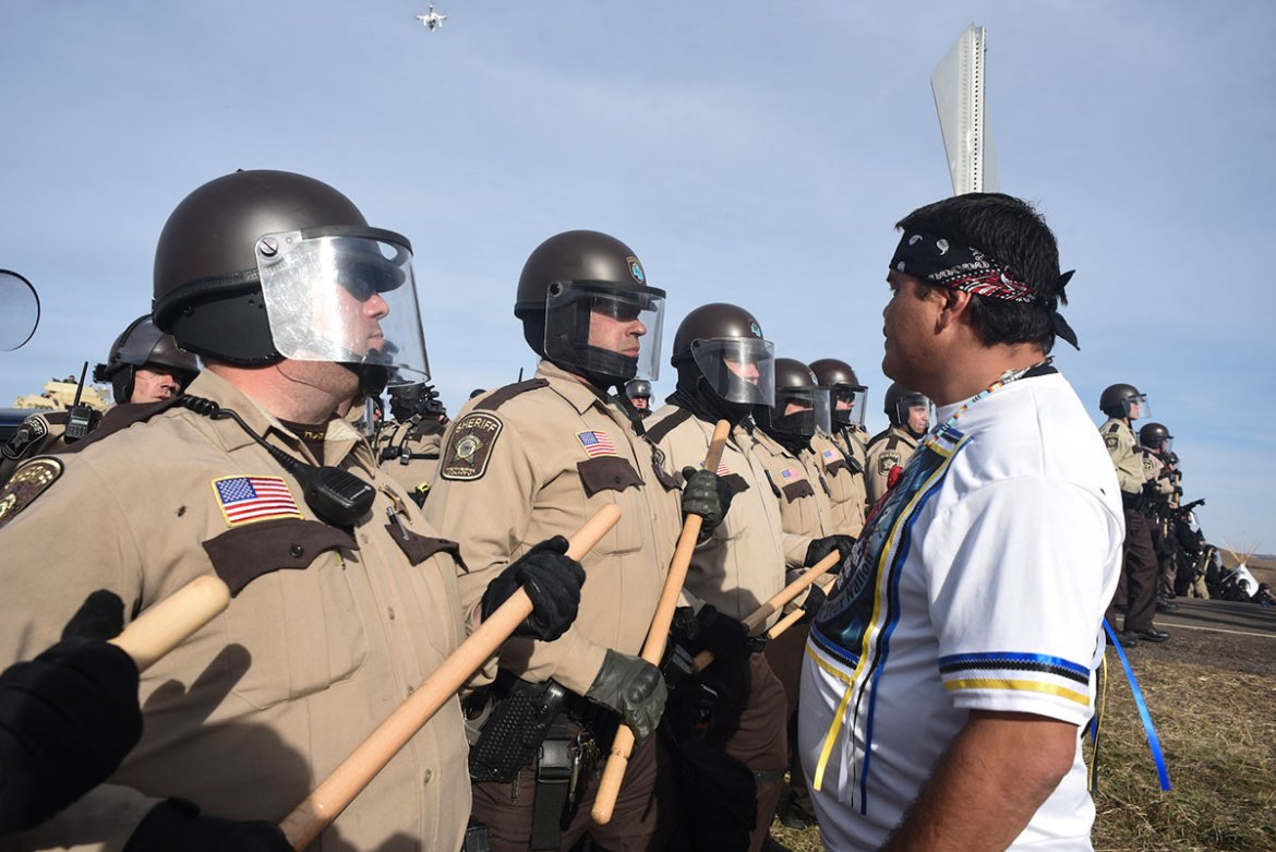 A protester confronts the police line as it presses through the protest camp. [Jason Patinkin/Al Jazeera]