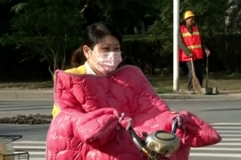 The cold weather is prompting people to wrap up warm [CCTV]