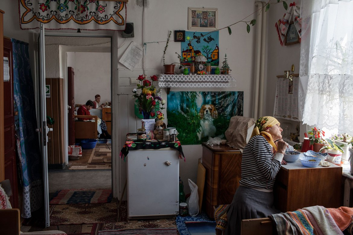 Old people living in an elderly care centre in Leorda, Romania. There are 72 elderly living in that centre, being cared for by only one medical nurse and two other personnel, who work in 12-hour shifts. [Ioana Moldovan/Al Jazeera]