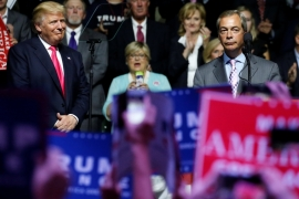 Donald Trump watches as Member of the European Parliament Nigel Farage speaks at a campaign rally in Jackson, Mississippi, US [Reuters]