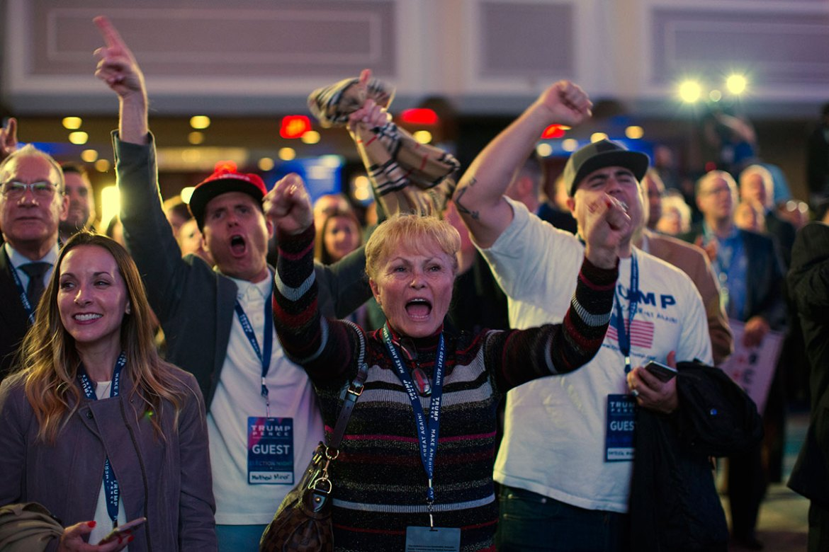 Supporters of Trump cheer during an election night rally. [ Evan Vucci/AP]