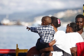 Refugees look at Sicily from on board the rescue vessel Responder on October 22 [EPA]
