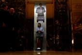 A worker yawns as the elevator doors close in the lobby of Trump Tower in New York [Reuters]