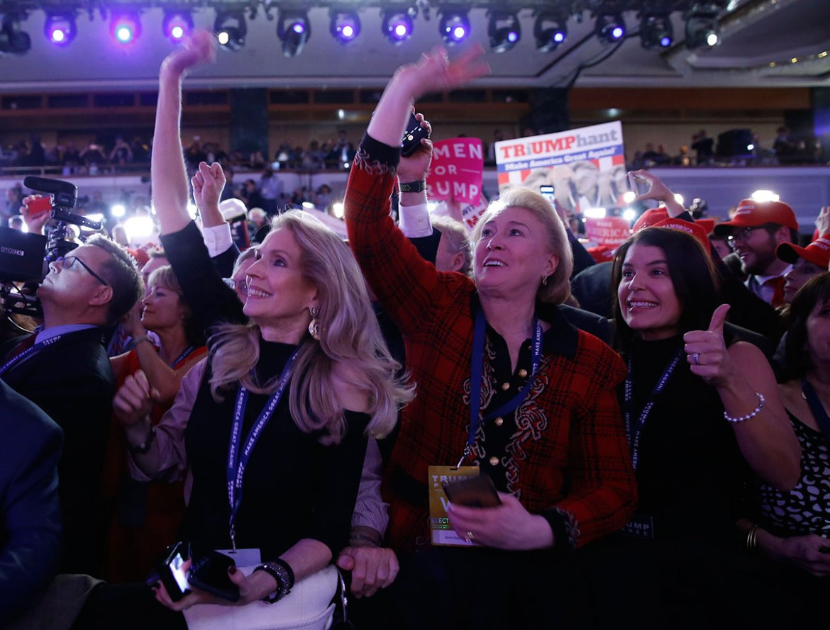 Excitement mounts as Trump supporters await his arrival at his election night rally in Manhattan. [Carlo Allegri/Reuters]