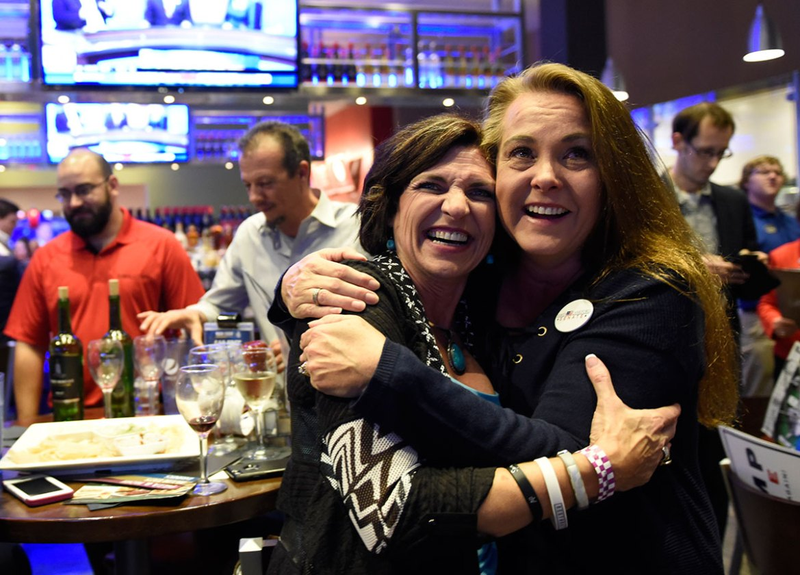 Chandra Ford, left, and Tempe Perreira celebrate as Trump is announced the winner of Ohio at the Oklahoma Republican watch party in Oklahoma City, Oklahoma. [Nick Oxford/Reuters]
