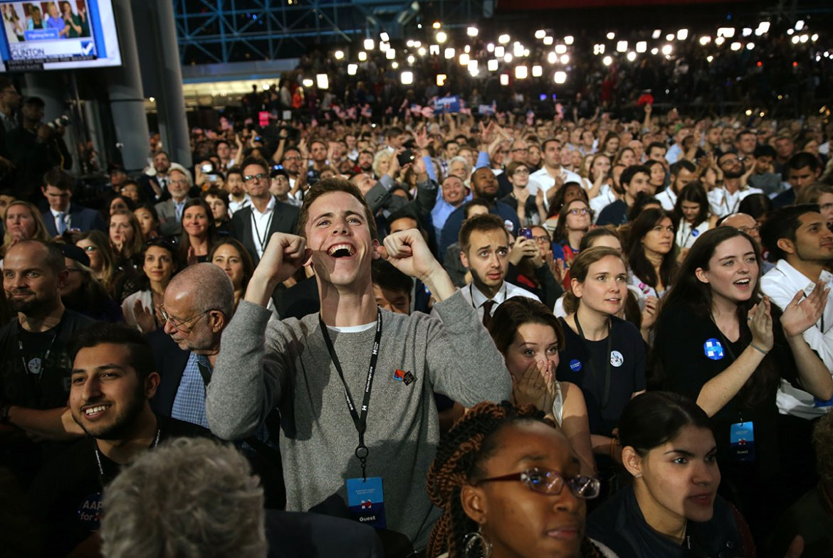 Supporters of Clinton cheer at her election night rally in New York. [Carlos Barria /Reuters]