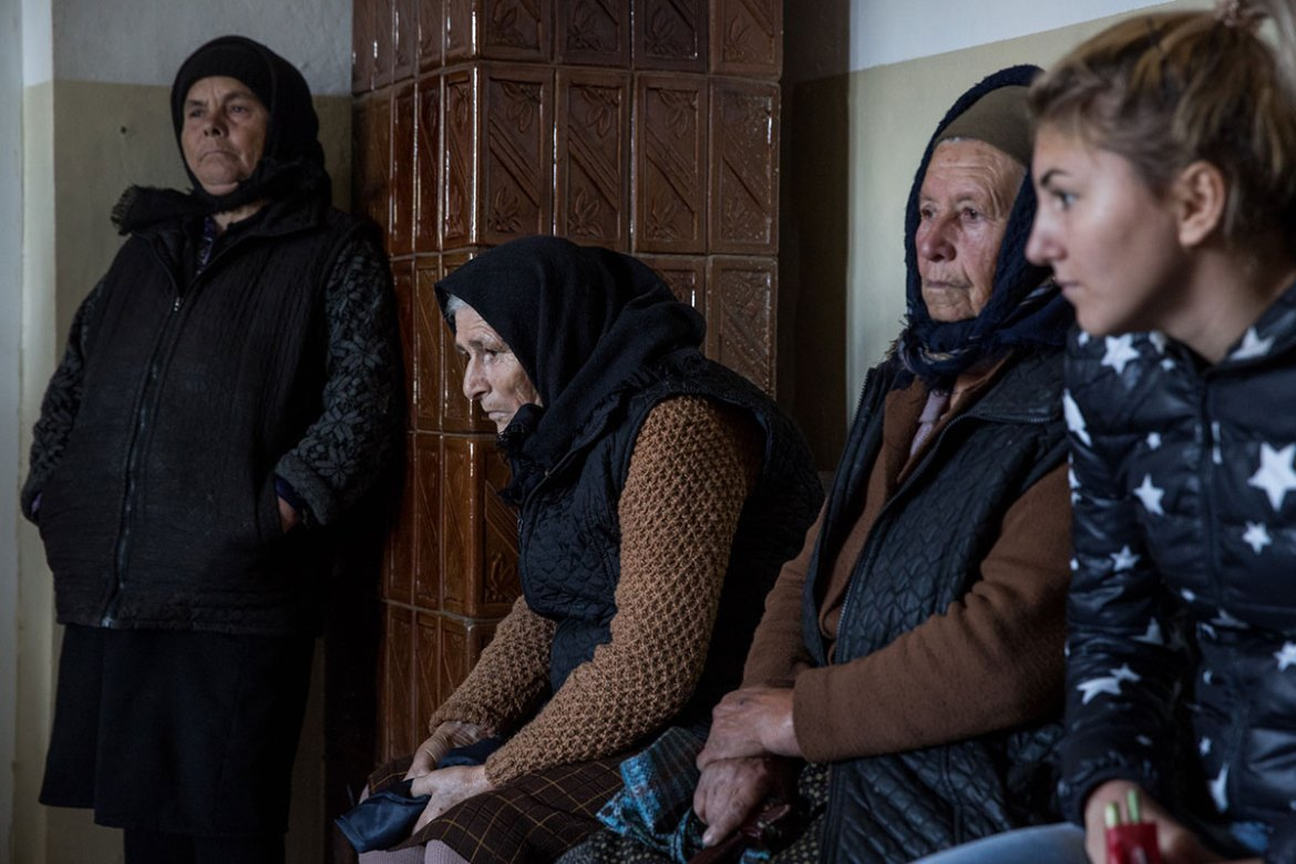 Patients waiting at a clinic of a family doctor in Gangiova commune. The majority of patients that can benefit from health insurance are retirees and people on social welfare. [Ioana Moldovan/Al Jazeera]