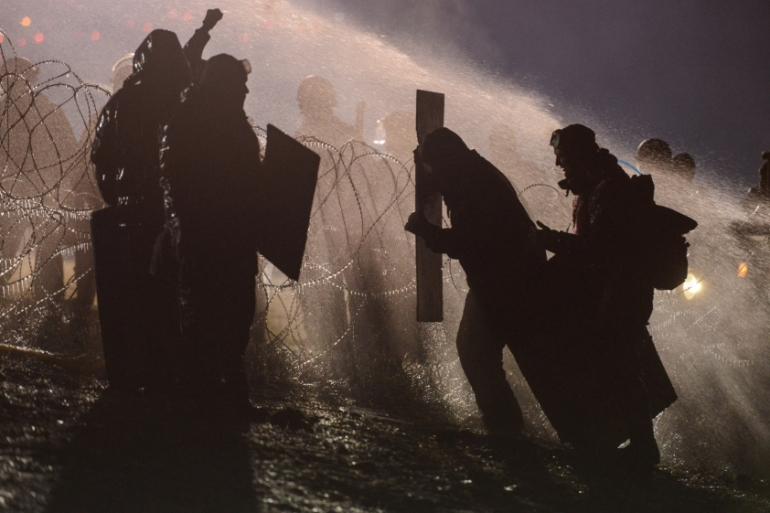 Police use a water cannon on activists during a protest against plans to pass the Dakota Access pipeline near the Standing Rock Indian Reservation, North Dakota, US on November 20 [Reuters]