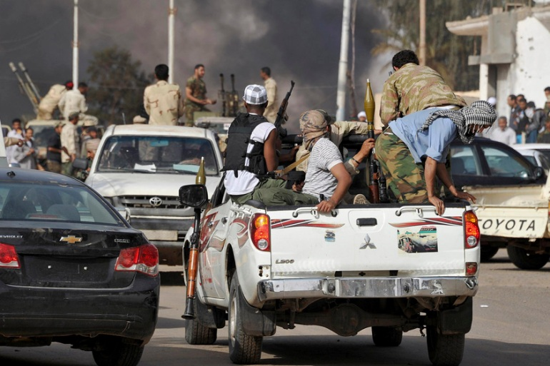 Rival militias clash in southern Sabha city in this March 2012 file photo [Reuters]
