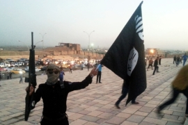 FILE: An ISIL fighter in the city of Mosul, the armed group's last stronghold in Iraq [Reuters]
