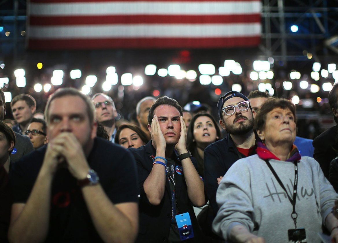 Stunned Democratic supporters watch the results come in at Hillary Clinton's election night rally in New York. [Carlos Barria/ Reuters]