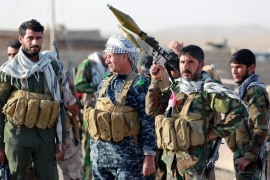 Reconciliation efforts took a hit last month when the Iraqi parliament approved a law legalising the Popular Mobilisation Forces, a group of powerful Shia militias [EPA]