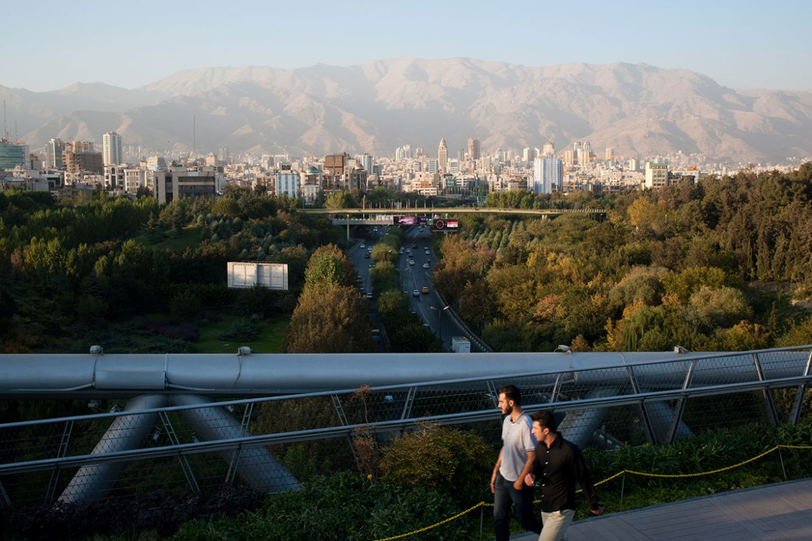 Friday is holiday in Iran and people spend the day in the city's green spaces, such as Taleghani and Ab-o-Atash, two parks recently connected by Tabiat Bridge. The bridge was designed by architect Leila Araghian. She was 26 when she started work on it. [Linda Dorigo/Al Jazeera]