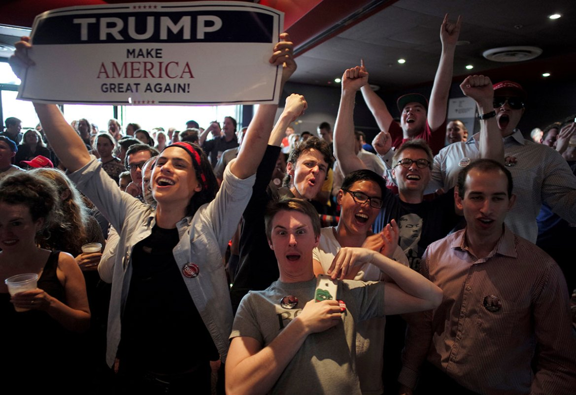 Cheers from Trump supporters when a state is called in favour of the Republican candidate as students watch the live results of the US presidential election at the University of Sydney in Australia. [Jason Reed/Reuters]
