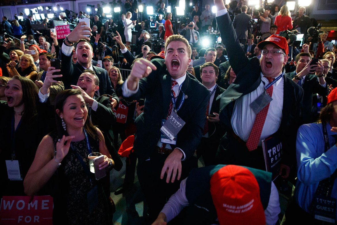 Supporters of Trump cheer as they watch election returns during an election night rally. [Evan Vucci/AP]