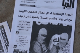 On a floor in Fadlie were copies of what appeared to be an ISIL-published newspaper called Al Nabaa News [Salam Khoder/Al Jazeera]