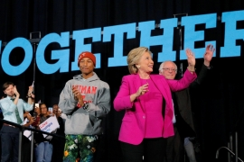 Clinton is seeking the company of stars like Pharrell Williams and Bernie Sanders to draw crowds [Brian Snyder/Reuters]